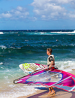 A windsurfer looking out at the ocean at Ho'okipa Beach, Maui.