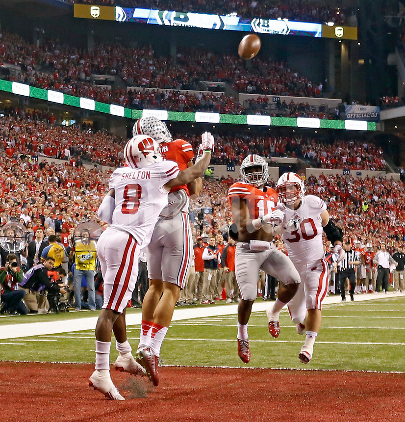 Ohio State Buckeyes wide receiver Devin Smith (9) makes a touchdown against Wisconsin Badgers cornerback Sojourn Shelton (8) during the 1st quarter in the 2014 Big Ten Football Championship Game at Lucas Oil Stadium in Indianapolis, Ind. on December 6, 2014.  (Dispatch photo by Kyle Robertson)
