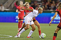 Portland, Oregon - Sunday September 11, 2016: Western New York Flash midfielder Lianne Sanderson (10) dribbles past Portland Thorns FC midfielder Allie Long (10) during a regular season National Women's Soccer League (NWSL) match at Providence Park.