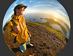 Trekker Jamie Woodall enjoys the sunrise view from the summit of Gunung Api, the volcano that forms the heart of the Banda Islands.