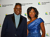 Singer Philip Bailey of Earth, Wind and Fire, and his wife, Valerie Bailey, arrive for the formal Artist's Dinner honoring the recipients of the 42nd Annual Kennedy Center Honors at the United States Department of State in Washington, D.C. on Saturday, December 7, 2019. The 2019 honorees are: Earth, Wind & Fire, Sally Field, Linda Ronstadt, Sesame Street, and Michael Tilson Thomas.<br /> Credit: Ron Sachs / Pool via CNP