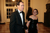 Randall Stephenson, chief executive officer of AT&T Inc., left, and Lenise Stephenson arrive to a state dinner hosted by U.S. President Barack Obama and U.S. First Lady Michelle Obama in honor of French President Francois Hollande at the White House in Washington, D.C., U.S., on Tuesday, Feb. 11, 2014. Obama and Hollande said the U.S. and France are embarking on a new, elevated level of cooperation as they confront global security threats in Syria and Iran, deal with climate change and expand economic cooperation. <br /> Credit: Andrew Harrer / Pool via CNP