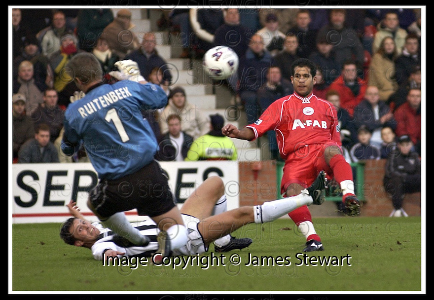 02/01/2002                 Copyright Pic : James Stewart .Ref :     .File Name : stewart-dunf v abdeen 01.MARCO RUITENBEEK SAVES A CLOSE RANGE FROM HICHAM ZEROUALI.......James Stewart Photo Agency, Stewart House, Stewart Road, Falkirk. FK2 7AS      Vat Reg No. 607 6932 25.Office     : +44 (0)1324 630007     .Mobile  : + 44 (0)7721 416997.Fax         :  +44 (0)1324 630007.E-mail  :  jim@jspa.co.uk.If you require further information then contact Jim Stewart on any of the numbers above.........