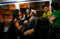 Ceci (left) travels on a bus with Meme and other dancer friends on their way to her mother's house to celebrate her birthday. Ceci and Meme are tango dancing partners and work at a restaurant in the El Caminito area of Buenos Aires.