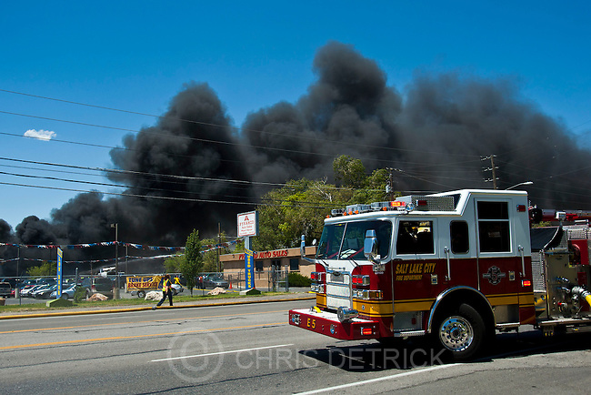 Chris Detrick  |  The Salt Lake Tribune.Salt Lake City fire crews battle a fire near Pyramid Auto Sales Tuesday July 3, 2012. The fire, which began at about 1 p.m. at 1052 S. Redwood Road, was moving northwest toward some businesses about an hour later.