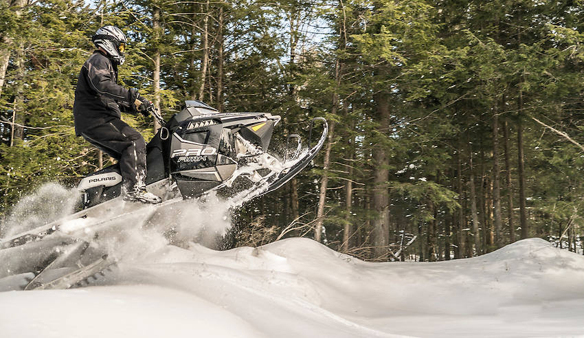 Backcountry snowmobiling on mountain sleds, Michigan's Upper Peninsula.