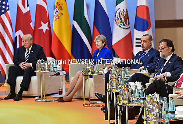 07.07.2017; Hamburg, Germany: THERESA MAY SIDELINED AT G20 SUMMIT<br /> Both President Donald Trump and President Recep Erdogan appear to ignore Theresa May.<br /> Mandatory Credit Photo: &copy;NEWSPIX INTERNATIONAL<br /> <br /> IMMEDIATE CONFIRMATION OF USAGE REQUIRED:<br /> Newspix International, 31 Chinnery Hill, Bishop's Stortford, ENGLAND CM23 3PS<br /> Tel:+441279 324672  ; Fax: +441279656877<br /> Mobile:  07775681153<br /> e-mail: info@newspixinternational.co.uk<br /> **All Fees Payable To Newspix International**