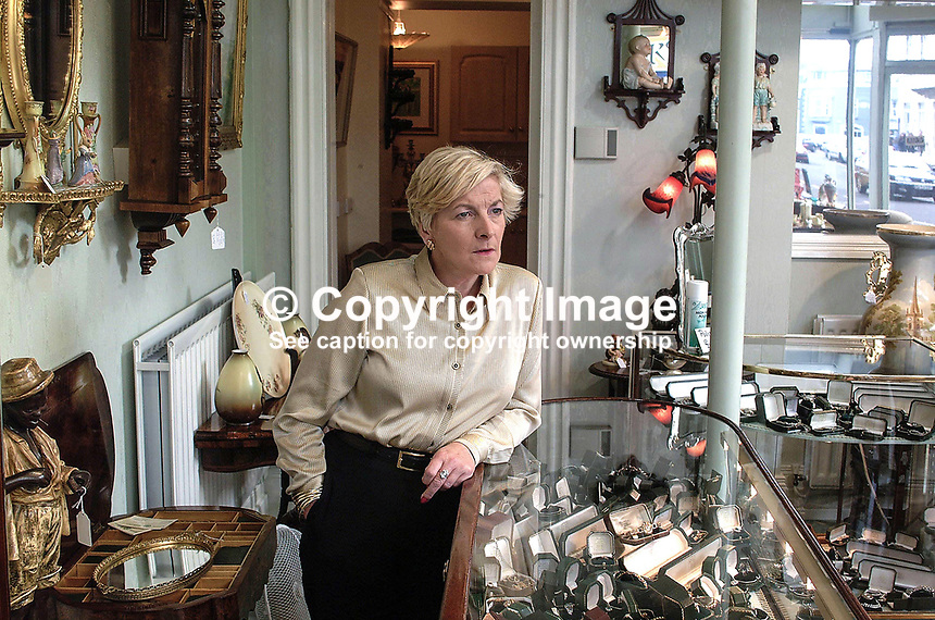 Eleanor Wolfenden, Kennedy Wolfendden &amp; Co Ltd, Portrush, N Ireland, antiques dealer, 200109083282.<br /> <br /> Copyright Image from Victor Patterson,<br /> 54 Dorchester Park, <br /> Belfast, UK, BT9 <br /> <br /> t1: +44 28 9066 1296 (from Rep of Ireland 048 90661296)<br /> t2: +44 28 9002 2446 (from Rep of Ireland 048 9002 2446)<br /> <br /> m: +44 7802 353836<br /> <br /> e: victorpatterson@me.com<br /> www.victorpatterson.com<br /> <br /> Please see my Terms and Conditions of Use at www.victorpatterson.com. It is IMPORTANT that you familiarise yourself with them.<br /> <br /> Images used on the Internet must be visibly watermarked i.e. &copy; Victor Patterson<br /> within the body of the image and copyright metadata must not be deleted. Images <br /> used on the Internet have a size restriction of 4kbs and will be chargeable at current<br />  NUJ rates unless agreed otherwise.<br /> <br /> This image is only available for the use of the download recipient i.e. television station, newspaper, magazine, book publisher, etc, and must not be passed on to any third <br /> party. It is also downloaded on condition that each and every usage is notified within 7 days to victorpatterson@me.com<br /> <br /> The right of Victor Patterson to be identified as the author is asserted in accordance with The Copyright Designs And Patents Act (1988). All moral rights are asserted.