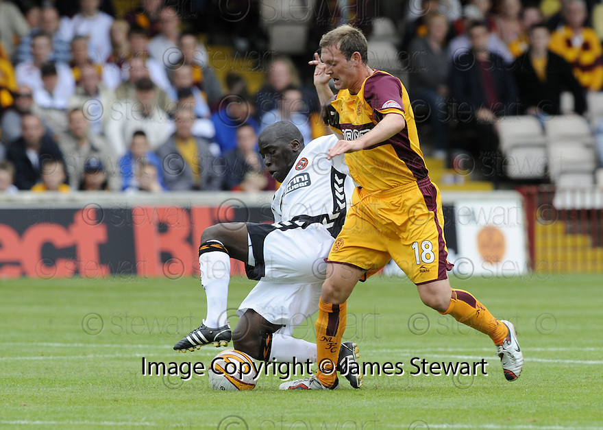 23/08/2008  Copyright Pic: James Stewart.File Name : sct_jspa25_motherwell_v_dundee_utd.MORGARO GOMIS CHALLENGES STEVEN MCGARRY.James Stewart Photo Agency 19 Carronlea Drive, Falkirk. FK2 8DN      Vat Reg No. 607 6932 25.James Stewart Photo Agency 19 Carronlea Drive, Falkirk. FK2 8DN      Vat Reg No. 607 6932 25.Studio      : +44 (0)1324 611191 .Mobile      : +44 (0)7721 416997.E-mail  :  jim@jspa.co.uk.If you require further information then contact Jim Stewart on any of the numbers above........