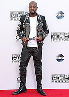 LOS ANGELES, CA, USA - NOVEMBER 23: Wyclef Jean arrives at the 2014 American Music Awards held at Nokia Theatre L.A. Live on November 23, 2014 in Los Angeles, California, United States. (Photo by Xavier Collin/Celebrity Monitor)