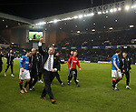 Ally mcCoist leads his team around the park after clinching the SPFL League One title