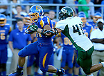 BROOKINGS, SD - SEPTEMBER 6:  Zach Zenner #31 from South Dakota State University tries to slip the tackle of Nick Dzubnar #41 from Cal Poly in the first half of their game Saturday evening at Coughlin Alumni Stadium in Brookings.(Photo/Dave Eggen/Inertia)