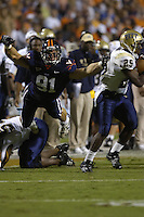 29 September 2007:  Virginia DE Chris Long (91) leaps through the air to tackle Pitt RB LeSean McCoy (25).  The Virginia Cavaliers defeated the Pittsburgh Panthers 44-14 September 29, 2007 at Scott Stadium in Charlottesville, VA..