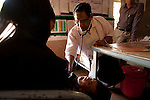 Dr Nisar Ahmed examines a malnourished child at a UNICEF feeding centre in Shivpuri, Madhya Pradesh state in India. Despite 15 yeas of economic growth the incidence of child malnutrition has barely changed -- 46 percent of children under 5 in India are malnourished: twice the rate of sub Saharan Africa.. A report released last week said a mixture of poor governance , the caste system dis-empowerment of women and superstition are preventing children from getting the nutrition they need, condemning another generation to brain damage, low earning potential and early death. At the moment 3000 children a day die in India as a result of malnutrition.