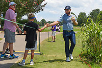 Tyrrell Hatton (ENG) high fives a young fan on his way to the tee on 13 during round 2 of the WGC FedEx St. Jude Invitational, TPC Southwind, Memphis, Tennessee, USA. 7/26/2019.<br /> Picture Ken Murray / Golffile.ie<br /> <br /> All photo usage must carry mandatory copyright credit (© Golffile | Ken Murray)