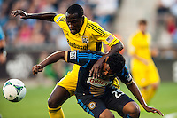 Tony Tchani (6) of the Columbus Crew battles for the ball with Sheanon Williams (25) of the Philadelphia Union. The Philadelphia Union defeated the Columbus Crew 3-0 during a Major League Soccer (MLS) match at PPL Park in Chester, PA, on June 5, 2013.