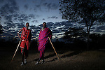 "TANZANIA - JULY 2:  Maasai Warriors ""Emmanuel"" and ""Paolo"", employed to ward off wild animals from a tourist camp, pose for a photo on July 2, 2010 in Tanzania, Africa. The Maasai are a Nilotic ethnic group of semi-nomadic people located in Kenya and northern Tanzania. Although the Tanzanian and Kenyan governments have instituted programs to encourage the Maasai to abandon their traditional semi-nomadic lifestyle, the people have continued their age-old customs. While the Maasai run cattle farms, they invade the habitats of the endangered lions in Kenya. As of 2010, there are only about 2,000 lions left in Kenya and at the rate the Maasai warriors kill them, the lions in Kenya could be gone within two years. There are many government programs which promote accepting compensation when a lion kills livestock, rather than hunting and killing the predator. Nevertheless, young warriors who engage in traditional lion killing do not face significant consequences and killing a lion gives one great value and celebrity status in the community."