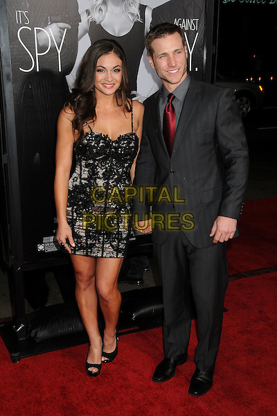 "Ashley Ann Vickers, Jake Pavelka.""This Means War"" Los Angeles Premiere held at Grauman's Chinese Theatre, Hollywood, California, USA..February 8th, 2012.full length dress black lace holding hands suit.CAP/ADM/BP.©Byron Purvis/AdMedia/Capital Pictures."
