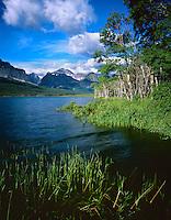 The peaks of Many Glacier rise beyond Sherburne Lake,GLACIER NATIONAL PARK, Montana