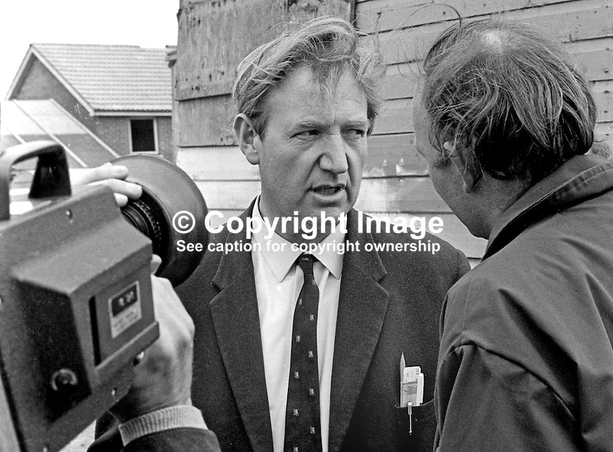 David Lindsay, clerk of works, at the Housing Executive building site, Ballyduff Road, Newtownabbey, where two Roman Catholic workers were murdered by the UDA/UFF on 7th May 1974, is interviewed by the media. The murder victims were Frederick Leonard, 20 years, from the Short Strand area of Belfast, and Patrick Jago, 55 years, from Andersonstown, Belfast. At the time the men were having lunch in a site hut. 197405070249A.<br />