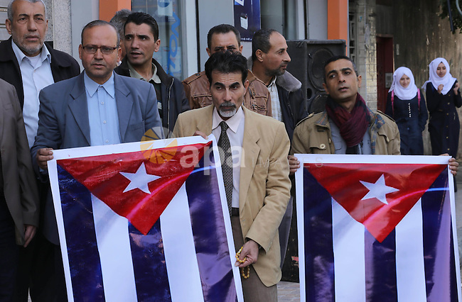Palestinian supporters of Palestinian People's Party take part in a rally to solidarity with of Cuban historic revolutionary leader Fidel Castro after his death, in Gaza city 27, 2016. Cuban revolutionary icon Fidel Castro died late Friday in Havana, his brother, President Raul Castro, announced on national television. Castro's ashes will be buried in the historic southeastern city of Santiago on December 4 after a four-day procession through the country. Photo by Mohammed Asad