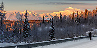 Photographer takes photos of Winter landscape of clearing storm over the south side view of Denali (Mt. Mckinley) and  the Alaska Range and snow-covered forest. Southcentral, Alaska <br /> <br /> Photo by Jeff Schultz/SchultzPhoto.com  (C) 2016  ALL RIGHTS RESVERVED