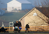 NICKEL MINES, PA -  APRIL 2:  Amish children head to their newly built schoolhouse April 2, 2007 in Nickel Mines, Pennsylvania. It was exactly 6 months from the day 5 of their fellow students were massacred in their old schoolhouse a short distance away. (Photo by William Thomas Cain/Getty Images)