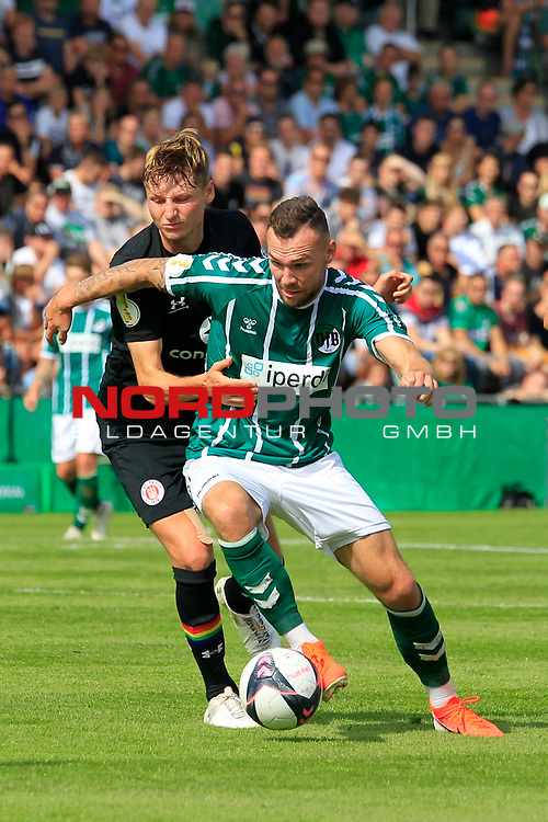 11.08.2019, Stadion Lohmühle, Luebeck, GER, DFB-Pokal, 1. Runde VFB Lübeck vs 1.FC St. Pauli<br /> <br /> DFB REGULATIONS PROHIBIT ANY USE OF PHOTOGRAPHS AS IMAGE SEQUENCES AND/OR QUASI-VIDEO.<br /> <br /> im Bild / picture shows<br /> Marc Hornschuh (FC St. Pauli) im Zweikampf gegen Patrick Hobsch (VfB Luebeck).<br /> <br /> Foto © nordphoto / Freund