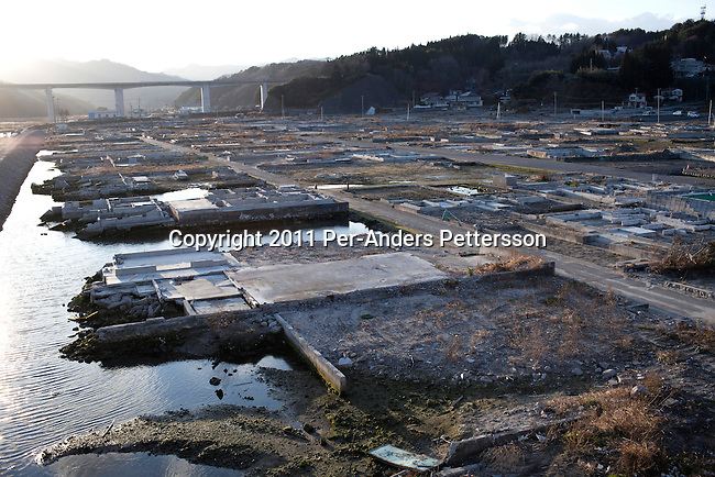 OTSHUSHI, JAPAN - DECEMBER 5: An area totally flattened on December 5, 2011, in Otshushi, Japan. The small town was almost wiped off the map during the tsunami and only a supermarket and Buddhist temple remain standing in the center of the town. Northeastern Japan's coastline was struck by an earthquake measuring 9.0 on the Richter scale and a Tsunami on March 11, 2011 which destroyed villages and livelihoods for hundreds of thousands of people. Almost 16,000 dead, thousands missing, more than 700,000 properties destroyed and an estimated 387,000 survivors lost their homes. Its estimated that it will take more than five years to rebuild. The cost is estimated to 309 billion U.S. dollars, the world's most expensive natural disaster. Many children suffered especially with school destroyed, education interrupted and the loss of family members took a heavy toll. (Photo by Per-Anders Pettersson)