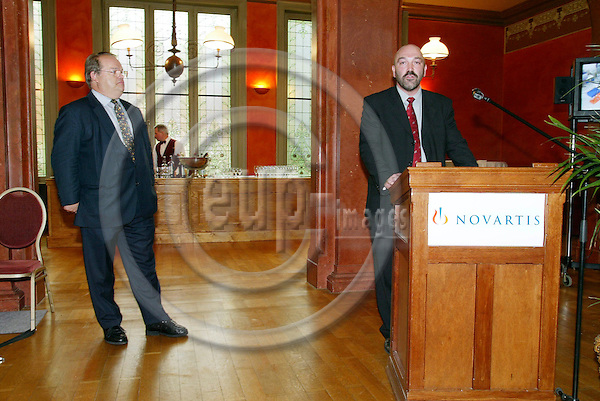 BRUSSELS - BELGIUM -14 JULY 2004--From left MEP John BOWIS and Stefaan VANCAYZEELE, Medical Director of Novartis, having a conversation at the Novartis Vision of Science Photographic Awards Exhibition at Solvay Library.--PHOTO: ERIK LUNTANG / EUP-IMAGES