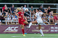 NEWTON, MA - AUGUST 29: McKenna Kennedy #26 of Boston University  and Jade Ruiters #13 of Boston College battle for the ball during a game between Boston University and Boston College at Newton Campus Field on August 29, 2019 in Newton, Massachusetts.