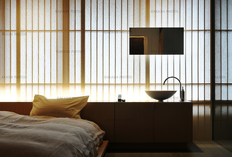 Bedroom at Fujiya Ryokan in Ginzan Onsen Village, traditional inn redesigned by the japanese architect Kengo Kuma in 2004.
