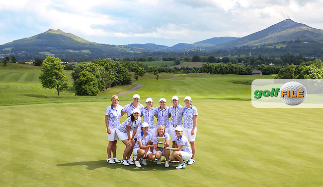 Victorious Team GB&amp;I with the 2016 Curtis Cup on the 18th green, played at Dun Laoghaire GC, Enniskerry, Co Wicklow, Ireland. 12/06/2016. Picture: David Lloyd | Golffile. <br /> <br /> All photo usage must display a mandatory copyright credit to &copy; Golffile | David Lloyd.