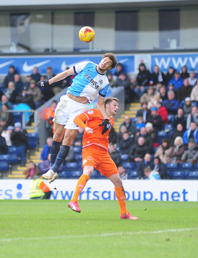 Blackburn's Rudy Gestede gets above  Blackpool's Gary Madine<br /> <br /> Photographer Andrew Vaughan/CameraSport<br /> <br /> Football - The Football League Sky Bet Championship - Blackburn Rovers v Blackpool - Saturday 21st February 2015 - Ewood Park - Blackburn<br /> <br /> &copy; CameraSport - 43 Linden Ave. Countesthorpe. Leicester. England. LE8 5PG - Tel: +44 (0) 116 277 4147 - admin@camerasport.com - www.camerasport.com