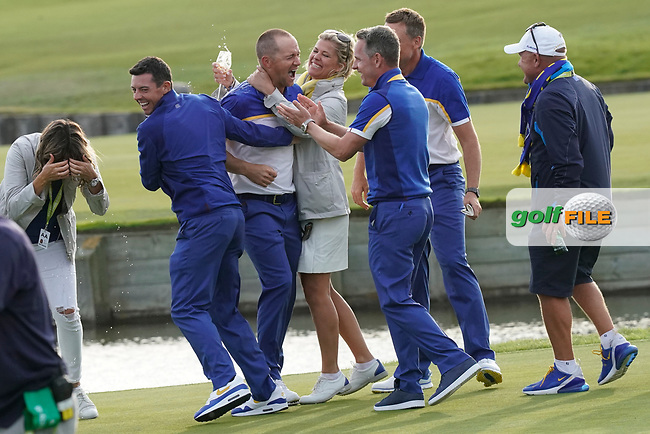 Team Europe celebrations go wild on the 18th green at the Ryder Cup, Le Golf National, Iles-de-France, France. 30/09/2018.<br /> Picture Claudio Scaccini / Golffile.ie<br /> <br /> All photo usage must carry mandatory copyright credit (© Golffile | Claudio Scaccini)