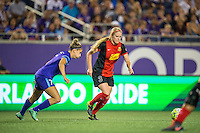 Orlando, Florida - Sunday, May 14, 2016: Western New York Flash forward Makenzy Doniak (3) cuts the ball across Orlando Pride defender Stephanie Catley (7) during a National Women's Soccer League match between Orlando Pride and New York Flash at Camping World Stadium.