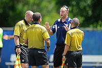 10 September 2011:  FIU Assistant Coach Chris Rich speaks with officials in between overtime periods as the FIU Golden Panthers defeated the Stetson University Hatters, 3-2 in the second overtime period, at University Park Stadium in Miami, Florida.
