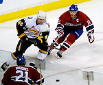 23 October 2006: Montreal Canadiens center Saku Koivu (11) of Finland, attempts to gain control of the puck from Buffalo defenseman Dmitri Kalinin (45) in the third period of play against the Montreal Canadiens at the Bell Centre in Montreal. The Sabres defeated the Canadiens 4-1 to increase their season-opening winning streak to 9 games. Mandatory photo credit: Ed Wolfstein Photo.<br />  *** Editorial Sales through Icon Sports Media *** www.iconsportsmedia.com