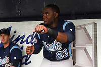 Corpus Christi Hooks first baseman Telvin Nash (23) keeps entertained during a rain delay against the NW Arkansas Naturals on May 26, 2014 at Arvest Ballpark in Springdale, Arkansas.  NW Arkansas defeated Corpus Christi 5-3.  (Mike Janes/Four Seam Images)