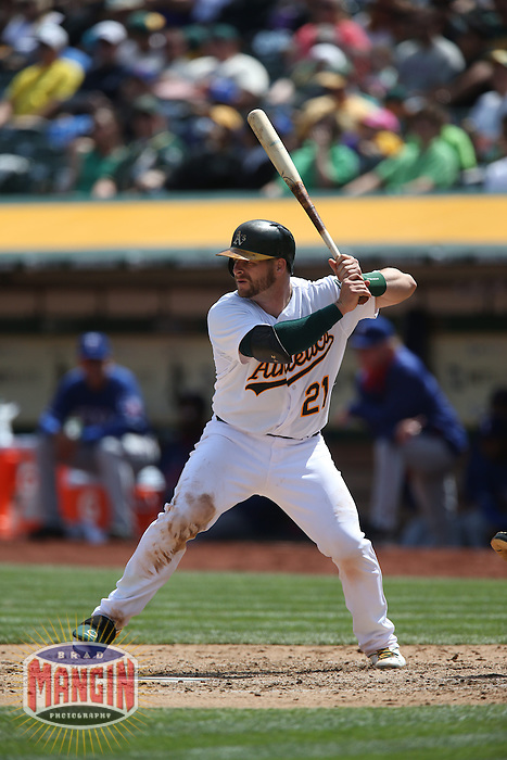 OAKLAND, CA - APRIL 9:  Stephen Vogt #21 of the Oakland Athletics bats against the Texas Rangers during the game at O.co Coliseum on Thursday, April 9, 2015 in Oakland, California. Photo by Brad Mangin