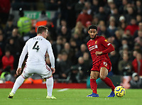 2nd January 2020; Anfield, Liverpool, Merseyside, England; English Premier League Football, Liverpool versus Sheffield United; Trent Alexander-Arnold of Liverpool passes the pass past John Fleck of Sheffield United - Strictly Editorial Use Only. No use with unauthorized audio, video, data, fixture lists, club/league logos or 'live' services. Online in-match use limited to 120 images, no video emulation. No use in betting, games or single club/league/player publications
