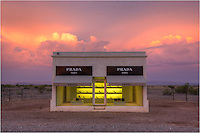 Between Van Horn and Valentine, Texas, a long US Highway 90 in the Chihuahuan desert, sits a permanent display of adobe brick, plaster, paint, glass, and several prada shoes and bags provided by the one and only Miuccia Prada. <br /> <br /> This West Texas landmark, often called Prada Marfa or Marfa Prada, was inaugurated on October 1, 2005, and cost ~ $80,000 to build. The building and concept is the plan of  Elmgreen and Dragset and was assisted by American architects Ronald Rael and Virginia San Fratello.