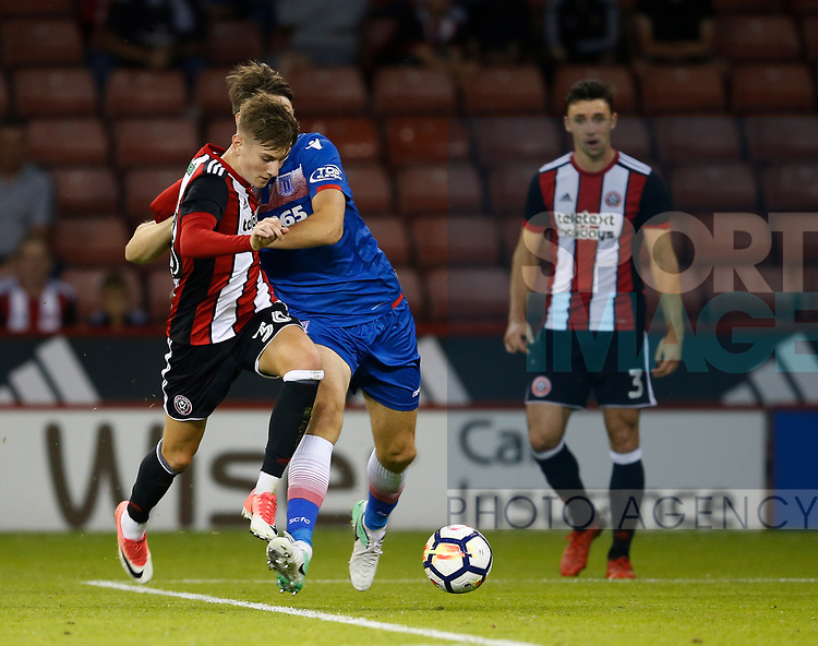 David Brooks of Sheffield Utd tussles with Philipp Wollscheid of Stoke City during the pre season friendly at Bramall Lane Stadium, Sheffield. Picture date: July 25th 2017. Picture credit should read: Simon Bellis/Sportimage