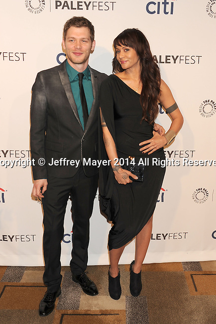 HOLLYWOOD, CA- MARCH 22: Actor Joseph Morgan (L) and actress Persia White attend the 2014 PaleyFest - 'The Vampire Diaries' & 'The Originals' held at Dolby Theatre on March 21, 2014 in Hollywood, California.
