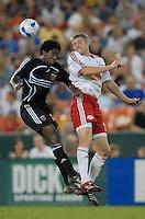 DC United midfielder Clyde Simms (19) goes for the header against New York Red Bulls forward John Wolyniec (15). DC United defeated the New York Red Bulls 3-1 at RFK Stadium in Washington DC, Thursday August  22, 2007.