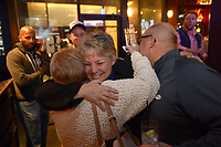 NWA Democrat-Gazette/ANDY SHUPE<br /> Denise Garner, candidate for State House District 84, gets a hug Tuesday, Nov. 6, 2018, as she enters the room during a watch party for the Washington County Democratic Party of Arkansas at Farrell's Lounge in Fayetteville.