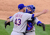 New York Mets pitcher Buddy Carlyle (43) and catcher Travis D'Arnaud (7) celebrate their team's opening day 3 -1 victory over the Washington Nationals at Nationals Park in Washington, D.C. on Monday, April 6, 2015.<br /> Credit: Ron Sachs / CNP<br /> (RESTRICTION: NO New York or New Jersey Newspapers or newspapers within a 75 mile radius of New York City)
