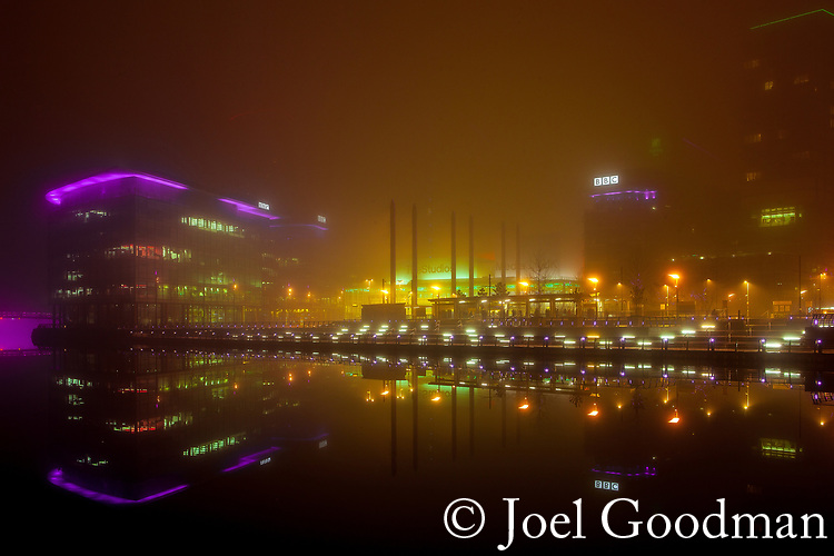 © Joel Goodman - 07973 332324 . 05/02/2012 . Salford , UK . The colourful skyline of Media City is visible through thick fog . Photo credit : Joel Goodman