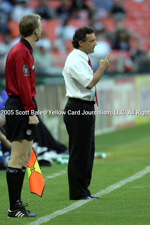 21 May 2005: DC United Head Coach Peter Nowak offers instruction from the sideline as the Assistant Referee looks on. DC United defeated the Kansas City Wizards 3-2 at RFK Stadium in Washington, DC in a regular season Major League Soccer game. .