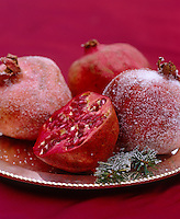 A detail of handmade sugared pomegranates used as Christmas decorations